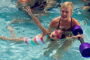 Buy barbells to practice at home the skills your child learns at Sea Otter Swim Lessons.